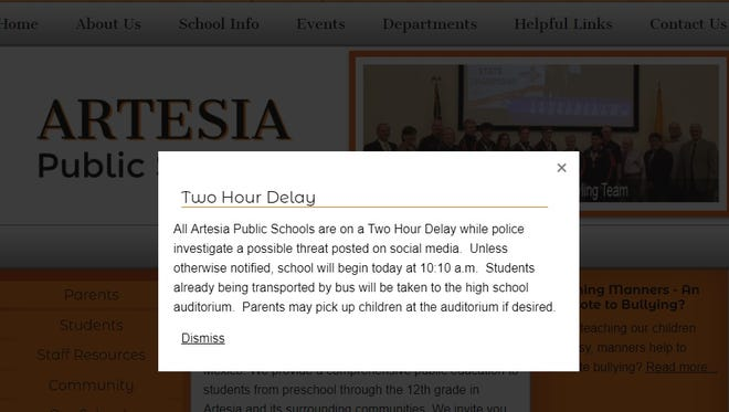 A notice on the Artesia Public Schools website informs parents and students of a two hour delay due to threats against students.