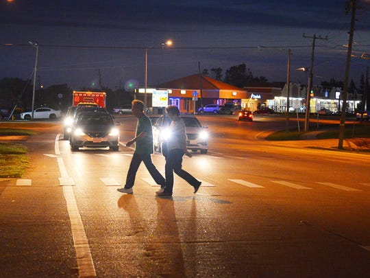 A couple crosses State Road A1A in Cocoa Beach. Brevard County was ranked third among the most dangerous places for pedestrians in the U.S.