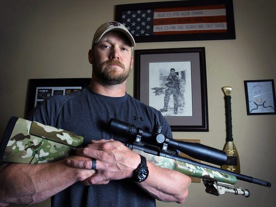 """Chris Kyle, a former Navy SEAL and author of the book """"American Sniper,"""" holds a weapon April 6, 2012, in Midlothian, Texas. Kyle and his friend, Chad Littlefield, were fatally shot at a shooting range southwest of Fort Worth on Feb. 2, 2013. Former Marine Eddie Ray Routh, who came with them to the range, has been found guilty in the murders."""