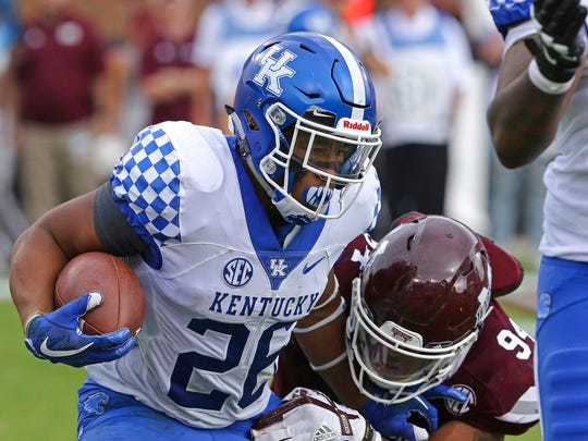 Mississippi State defensive lineman Jeffery Simmons (94) prepares to tackle Kentucky running back Benny Snell Jr. (26) during the first half of an NCAA college football game in Starkville, Miss., Saturday, Oct. 21, 2017. The play was called back for a penalty. (AP Photo/Jim Lytle)
