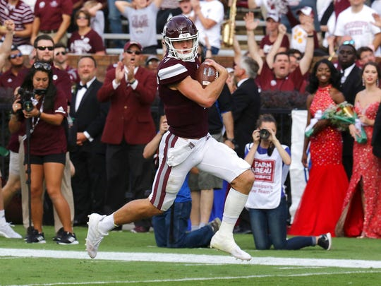 Mississippi State quarterback Nick Fitzgerald (7) sprints into the end zone during the first half against Kentucky.