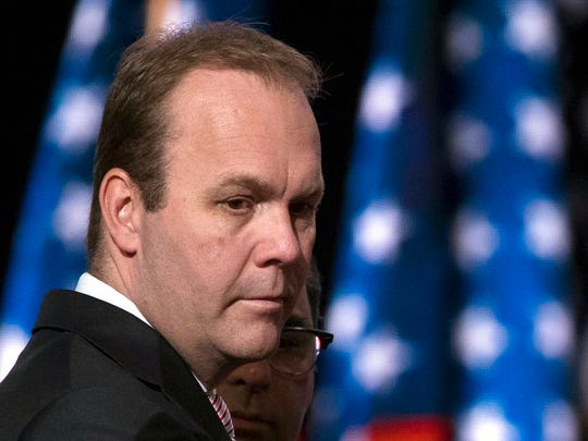 FILE - In this July 21, 2016 file photo, Rick Gates, campaign aide to Republican presidential candidate Donald Trump, at the Republican National Convention in Cleveland.  Trump's former campaign chairman, Paul Manafort, and a former business associate, Rick Gates, have been told to surrender to federal authorities Monday, according to reports and a person familiar with the matter.(AP Photo/Evan Vucci, File)