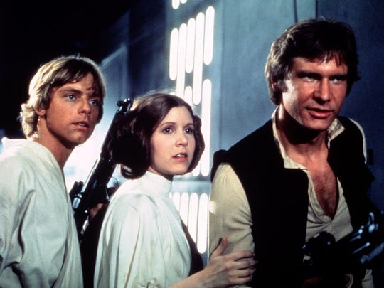 Luke (Mark Hamill, far left), Leia (Carrie Fisher) and Han (Harrison Ford) attempt to escape the Death Star in 1977's 'Star Wars.'