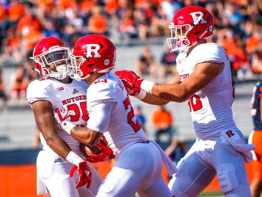 Rutgers running back Raheem Blackshear, left, is congratulated by wide receiver Dacoven Bailey (23) and tight end Nakia Griffin-Stewart (86) after his touchdown run in the first quarter of an NCAA college football game against Illinois, Saturday, Oct. 14, 2017, at Memorial Stadium in Champaign, Ill. (AP Photo/Bradley Leeb)