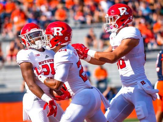 Rutgers running back Raheem Blackshear, left, is congratulated