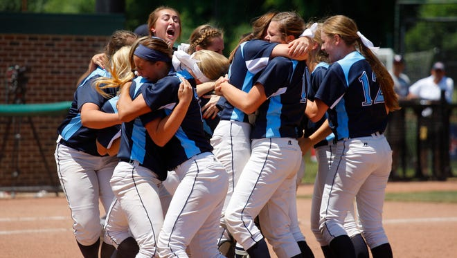Richmond players celebrate at the conclusion of their MHSAA championship game against Vickburg Saturday, June 18, 2016, at Michigan State University in East Lansing. Richmond won 2-0.
