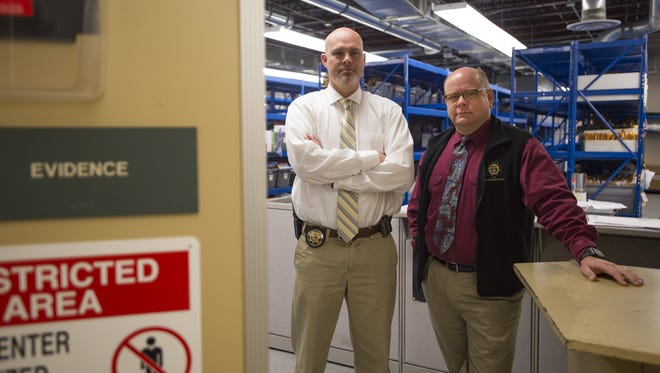 Investigator Andrew Weber and Sergeant Brian Wangler pose for a photo in the evidence room at the Larimer County Sheriff's Office on Thursday, Oct. 19, 2017. The pair worked to gather evidence used in the trial for Tanner Flores.