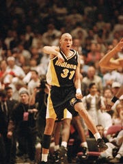 Reggie Miller celebrates at the end of the Pacers' Eastern Conference semifinals game against the Knicks, May 7, 1995.