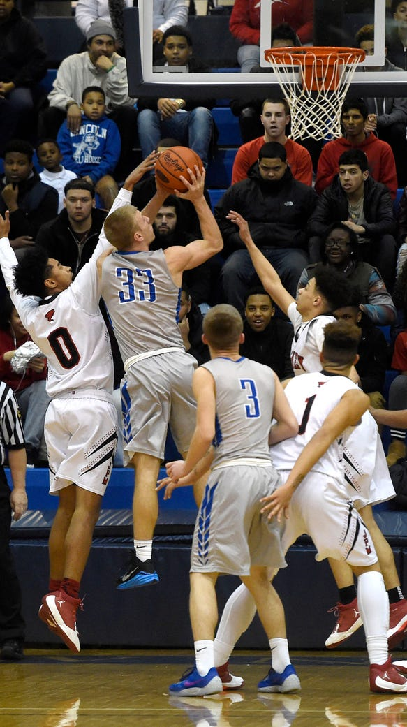 Cedar Crest's Evan Horn goes up for two against a McCaskey