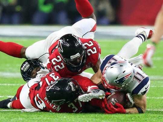 New England Patriots wide receiver Julian Edelman (11) makes a catch against the Atlanta Falcons during the fourth quarter during Super Bowl LI at NRG Stadium.