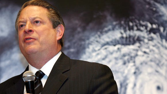 """In this 2007 file photo, former U.S. Vice President Al Gore speaks in front of a poster for his documentary film on global warming, """"An Inconvenient Truth,"""" during the Japanese premier in Tokyo."""