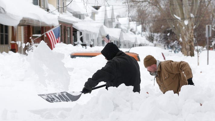 Mark Petrik and Dennis Smith dig out their south Buffalo