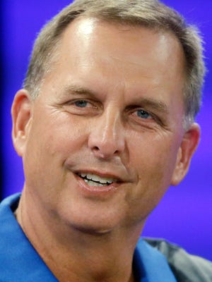 FILE - In this June 30, 2016, file photo, BYU offensive coordinator Ty Detmer speaks during an interview at NCAA college football media day in Provo, Utah. (AP Photo/Rick Bowmer, File)