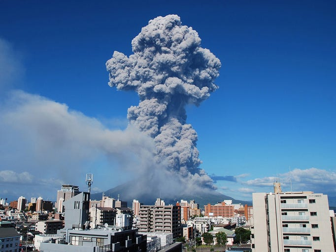 A cloud of smoke and ash rises from the Mt. Sakurajima volcano on Aug. 18 in Kagoshima City, Japan. The volcano's ash plume rose 16,000 feet into the air.