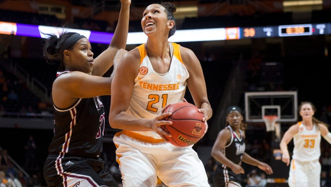 Tennessee's Mercedes Russell is defended by Troy's Dajia Williams on Dec. 21 at Thompson-Boling Arena.
