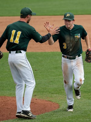 Green Bay Preble's Caleb Schoenholz (left) and Ryan Dougherty celebrate after Tuesday's victory over Middleton in a WIAA Division 1 state baseball quarterfinal at Neuroscience Group Field at Fox Cities Stadium in Grand Chute.