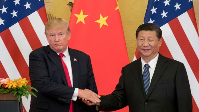 President Donald Trump and Chinese President Xi Jinping shake hands during a joint statement to members of the media Great Hall of the People in Beijing last November.