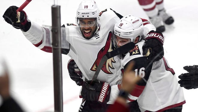 Arizona Coyotes' Anthony Duclair (10) celebrates with Max Domi (16) after scoring the game winning goal against the Ottawa Senators during overtime in an NHL hockey game in Ottawa, Saturday, Nov. 18, 2017. The Coyotes won 3-2 in overtime. (Justin Tang/The Canadian Press via AP)