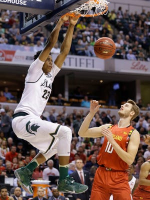 Michigan State forward Deyonta Davis dunks over Maryland forward Jake Layman in the first half of an NCAA college basketball game during the semifinals of the Big Ten Conference tournament in Indianapolis, Saturday, March 12, 2016.