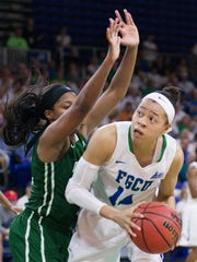 FGCU's Whitney Knight tries to score against Jacksonville during play Sunday in the Atlantic Sun Conference championship at Alico Arena in Fort Myers. Jacksonville beat FGCU 56-54.