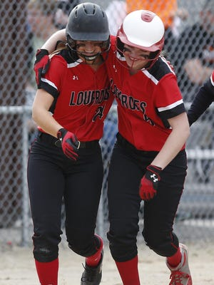 Lauren Schiek (24) gets congratulated by Brooklyn Berenz (5) after Schiek hit a two-run home run against Oakfield on Thursday.