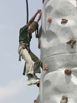 Aaliyah Shannon rock climbs at the Bellevue Community Picnic in 2010. This year's event is Saturday.