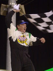 Steve Kinser of Bloomington Ind. celebrates after winning the championship race Saturday night Aug. 10 2002 at the Knoxville Nationals in Knoxville Iowa. (AP Photo/Charlie Neibergall)
