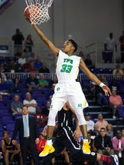 Patrick School's Al Amir Dawes scores against Sagemont during play Friday at the Culligan City of Palms Classic at the Suncoast Credit Union Arena in Fort Myers. Patrick beat Sagemont 80-62.