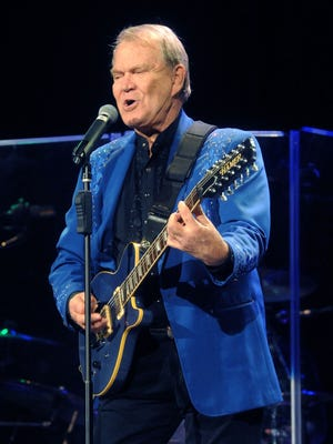Glen Campbell performs at the Ryman Auditorium on Nov. 30, 2011.