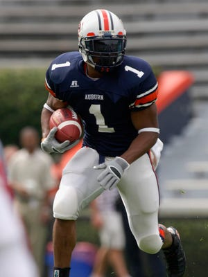 Auburn running back Brad Lester runs in the first half of a college football spring game in 2006.