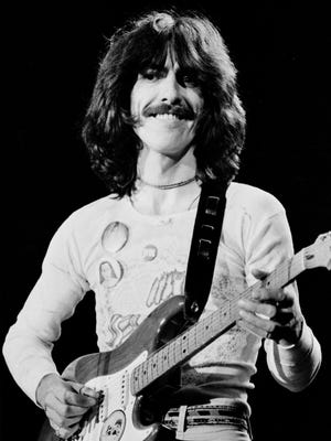 George Harrison, here in a 1974 file photo, would have been 75 on Feb. 25.
