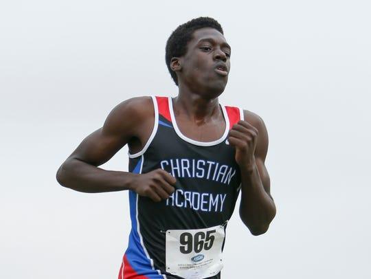 Christian Academy of Louisville Michael Florestal runs