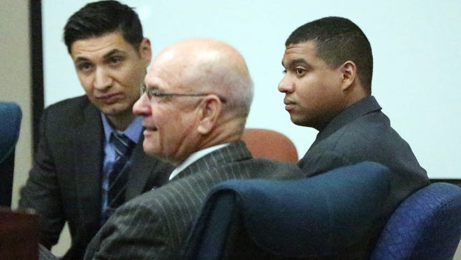 Devon Huerta-Person, right, sits with his attorneys, Adolfo Quijano Jr., center, and Eric Meza, left, Monday during jury selection in 384th District Court.