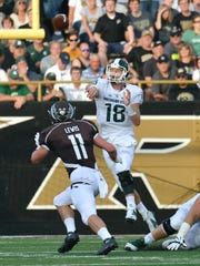 Michigan State quarterback Connor Cook throws early in the game as Western Michigan linebacker Austin Lewis applies pressure Friday at Waldo Stadium in Kalamazoo.