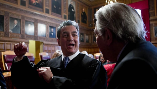 Associate Judge Michael Garcia, left, talks with former Chief Judge Sol Wachtler after Garcia was sworn in during a ceremony at the Court of Appeals on Monday, April 25, 2016, in Albany, N.Y.