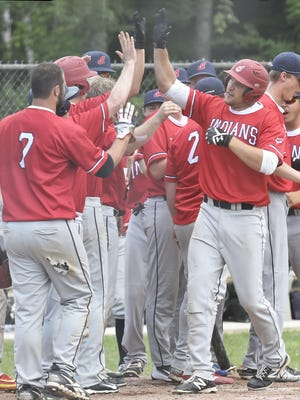 Egg Harbor's Cody Giesseman, right, is congratulated by teammates for one of his two home runs against Washington Island during Door County League baseball on Sunday at Egg Harbor.