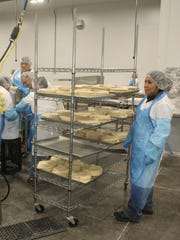 Workers at Willamette Valley Pie Company make turnovers.