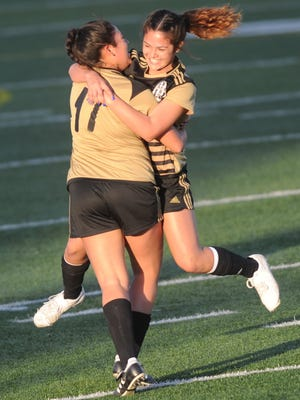 Abilene High's Avery Lara, right, celebrates with Leslie Velez after Lara scored off a pass from Velez to give the Lady Eagles a 1-0 lead over Cooper. AHS ended up winning the game 2-1 on Friday, Jan. 20, 2017 at Shotwell Stadium.