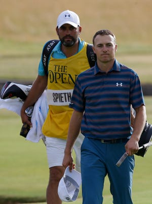 Jordan Spieth, right, walks off the 18th green after the final round of the British Open on Sunday.