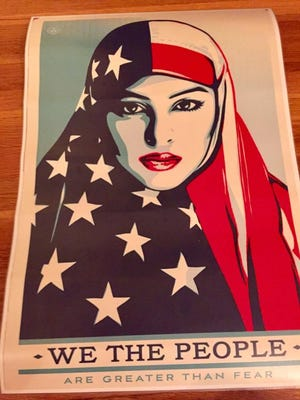 Alexandra Rucinski carried this banner, which featured a women in an American flag hijab, during the Women's March on Washington on Saturday, Jan. 21, 2016