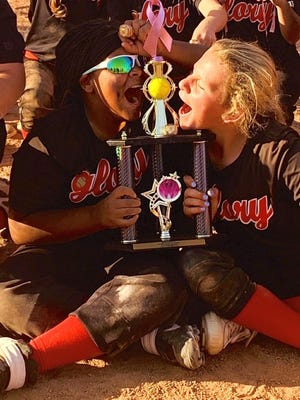 Glory 10U Sheffield team members Brenda Allen (left) and Corinne Sheffield celebrate after the team went 7-0 to win the Ninth Annual Hope For a Cure Tournament in Abilene.