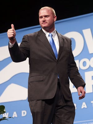 Jim Mowrer, candidate for Iowa's 3rd congressional district, gestures to the crowd at the 2014 Jefferson Jackson Dinner on Saturday, Oct. 25, 2014, at Hy-Vee Hall in Des Moines, Iowa.