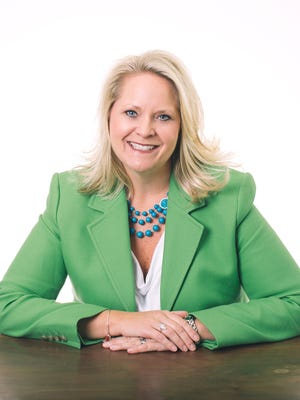Terrie Ard, president of Moore Communications Group.
