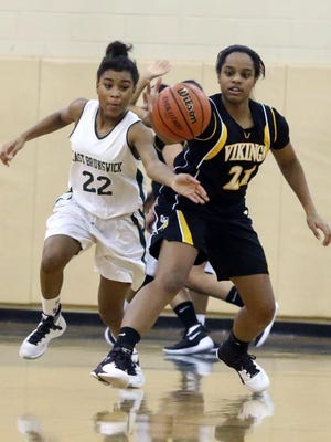 East Brunswick's Shanelle Colmon (22) competes with South Brunswick's Natalia Louhisdun for control of a loose ball.