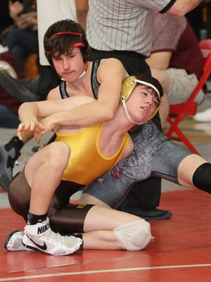 Frank Celli from Somers on his way to defeating Luke Rogers from Clarkstown South in the 138 pound weight class, during the Section 1 wrestling qualifier at Somers High School, Feb. 3, 2018.