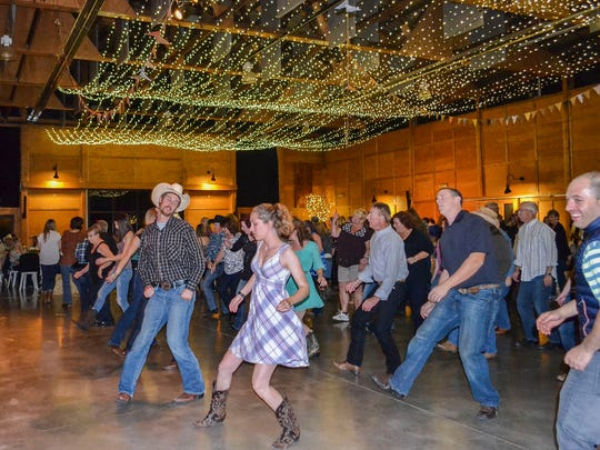 Pardners take to the floor at the annual Oregon Garden Barn Dance & Pig Roast