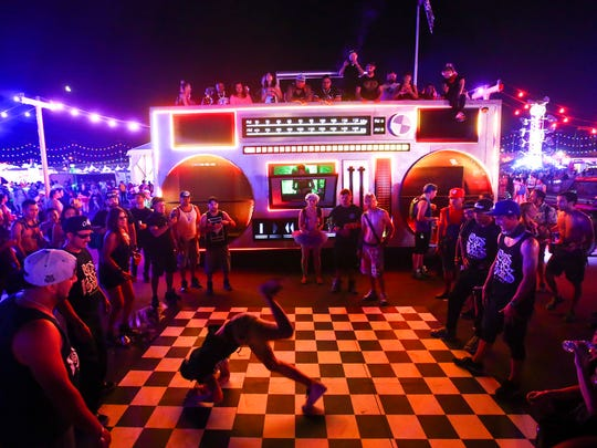 Breakdancers take turns showing off their moves by an art car during the first day of the Electric Daisy Carnival at the Las Vegas Motor Speedway on Saturday, June 17, 2017.