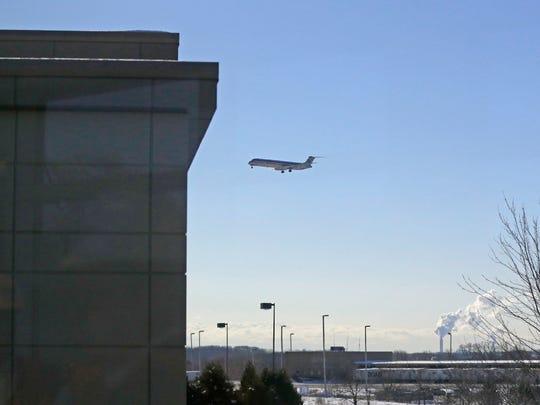 A passenger jet flies near Mitchell International Airport in Milwaukee