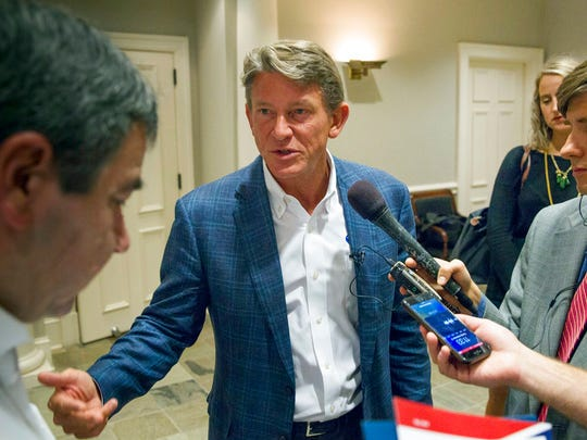 Businessman Randy Boyd speaks to reporters after a