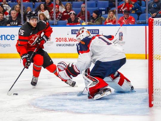 Canada's Jordan Kyrou, left, goes to the net against